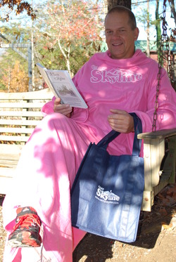 Pickle modeling Skyline's snuggie, cookbook, and grocery bag