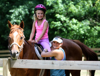Horseback riding staff at summer camp.